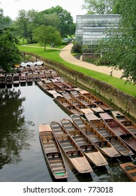 Punts tied up on the river Cherwell, Oxford, UK