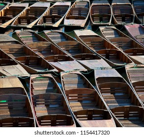 Punts tied up on the river isis or thames