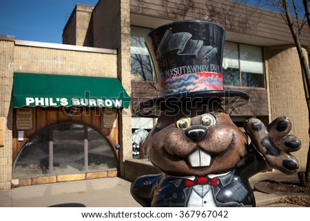 PUNXSUTAWNEY, PA MARCH 29: Statue of Punxsutawney Phil in front of Phils Burrow in downtown Punxsutawney, PA on March 29, 2015.