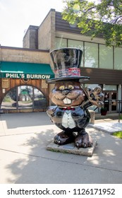 Punxsutawney, Pennsylvania, USA - June 30, 2018 :  Punxsutawney Phil, Groundhogs Day's official furry prognosticator, statue outside his official Burrow residence in Punxsutawney, Pennsylvania.