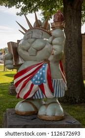 Punxsutawney, Pennsylvania, USA - June 30, 2018 :  Punxsutawney Phil, Groundhogs Day's official furry prognosticator,    statue dressed as Statue of Liberty in Punxsutawney, Pennsylvania.