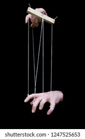 A pupeteer controlling a hand as if it is a puppet