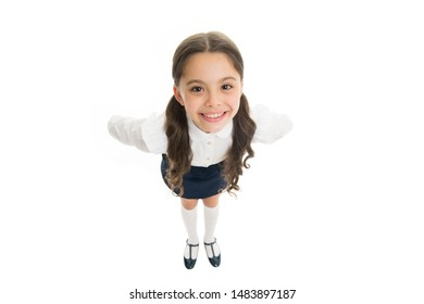 Pupil of first grade. School uniform. Back to school. Student little kid adores school. Smiling schoolgirl. Celebrate knowledge day. September time to study. Girl cute pupil on white background.