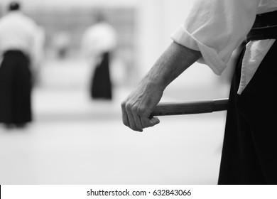 Pupil wearing a hakama katana sword before training in the martial arts of aikido