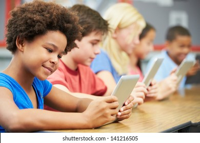 Pupils In Class Using Digital Tablet