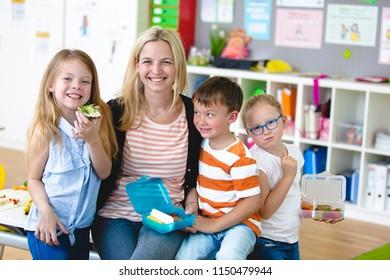 Pupils enjoy a healthy snack with their teacher