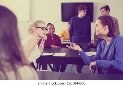 Pupils having conversation at recess in school