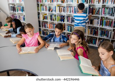 Pupils are reading books in library