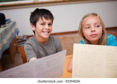 Pupils receiving their school report in a classroom