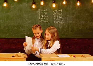 pupils in school uniform. two happy pupils in school uniform. school uniform for modern pupils. uniform for gilrs pupils at school
