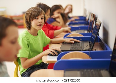 Pupils sitting at the computer science lesson