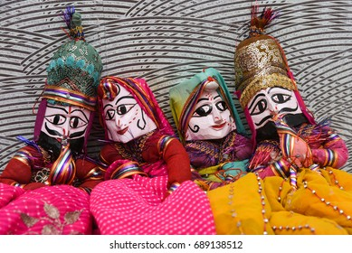 Puppet dance in a street, hand made dolls attached to string in Jaipur Rajasthan India.Men, women face with traditional Indian makeup wearing saree / sari / lehenga /choli dussehra dasara diwali