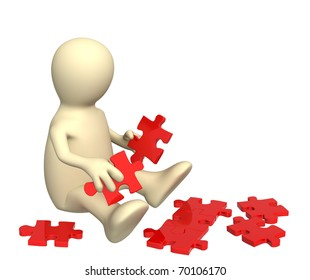 Puppet with parts of a puzzle. Isolated over white