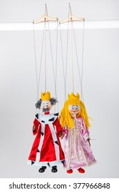 Puppets of king and queen, isolated on white