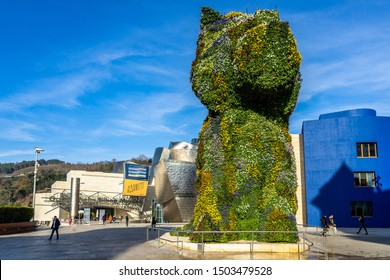 Puppy topiary sculpture by Jeff Koons on the terrace outside the Guggenheim Museum Bilbao. Bilbao, Basque Country, Spain, January 2019