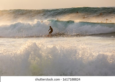 Pupukea, Oahu, Hawaii - November 05, 2019: surfers at the North Shore with unidentified people. This area is best known for its massive waves, attracting surfers from all around the globe