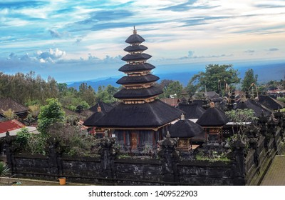 Pura Agung Besakih temple complex, holiest of all Balinese Hindu temple by blue sky. Summer landscape with religious building pura basuki puseh jagat at sunset on Bali, Indonesia