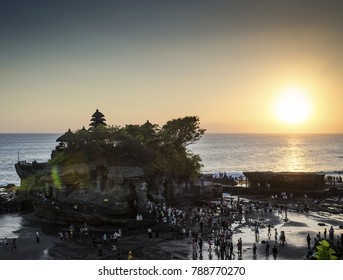 pura Goa Lawah hindu temple sunset backlight silhouette in bali indonesia
