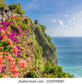 Pura Luhur Uluwatu temple, Bali, Indonesia. Amazing landscape - cliff with blue sky and sea