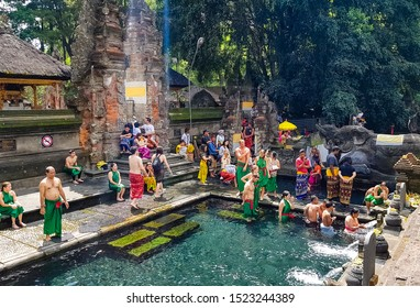 Pura Tirta Empul Temple, Tampaksiring, Bali, Indonesia - October 06, 2019: Hindu Balinese water temple famous for its holy spring water, where Balinese Hindus go to for ritual purification.
