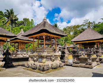Pura Tirta Empul Temple, Tampaksiring, Bali, Indonesia - October 06, 2019: Water temple with sculptures, famous for its holy spring water, where Balinese Hindus go to for ritual purification.