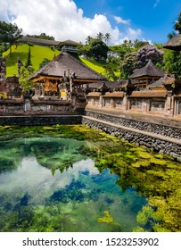 Pura Tirta Empul Temple, Tampaksiring, Bali, Indonesia - Green pond at the water temple famous for its holy spring water, where Balinese Hindus go to for ritual purification.