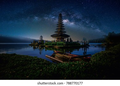 Pura Ulun Danu Bratan, Hindu temple with boat on Bratan lake landscape with milky way in Bali, Indonesia.