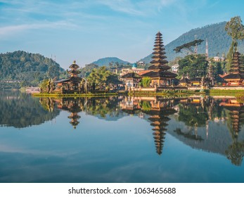 Pura Ulun Danu Bratan temple near Beratan lake in Bali island, Indonesia at sunrise. Iconic image of Bali and southeast asia. Travel background.