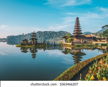 Pura Ulun Danu Bratan temple near Beratan lake in Bali island, Indonesia at sunrise. Iconic image of Bali and southeast asia. Travel background vertical image.