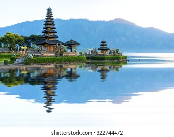 Pura Ulun Danu temple panorama reflection during sunrise on a lake Bratan, Bali, Indonesia