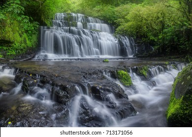Purakanui Falls, in the Catlins Forest Park is one of many beautiful waterfalls that are present within the Southern region of New Zealand