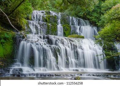 Purakaunui Falls, The Catlins, south island of New Zealand. Beautiful stairway waterfall.