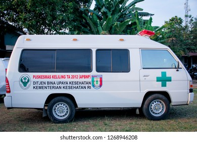 Purbalingga, Indonesia - 06th December 2013: An Ambulance Parking on the Side on the Road