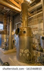 Purcellville, VA, USA - 1/10/20: Whiskey and moonshine alcohol or ethanol still distillery equipment Award winning Catoctin Creek Distilling Company in Purcellville, VA