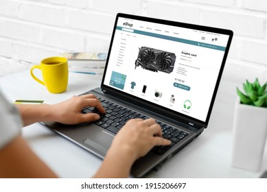 Purchase computer components online concept. Graphic card on modern ecommerce web site on laptop computer