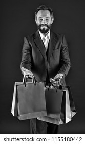 Purchase concept. Happy man with purchase in shopping bags. Bearded man smile with purchase. Purchase order, black and white.