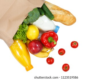 Purchase food purchases fruits and vegetables from above paper bag isolated on a white background