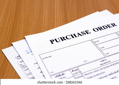 Purchase order form on wooden table