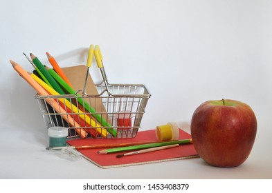 Purchase in supermarket. Stock up on creativity and learning. School supplies concept. Shopping basket with pencils and paints close up isolated white. Back to school.