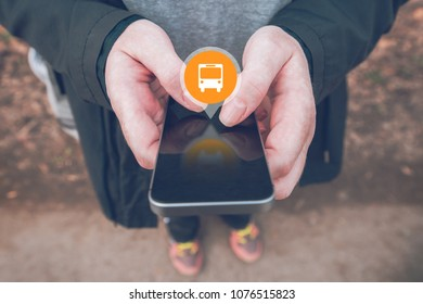 Purchasing electronic bus ticket with smartphone app, close up of female hands with mobile phone