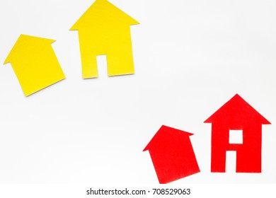 purchasing house with paper figure on work desk white background top view mock up