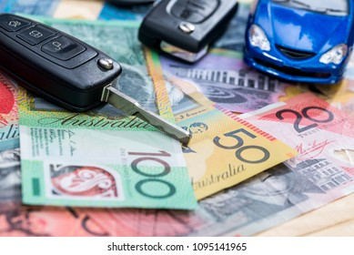 'Purchasing or rental' conception with toy car and australian dollars