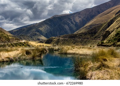 Pure blue water and golden grass in the Andes, Peru