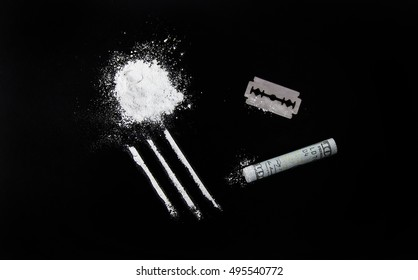 pure cocaine, drugs, blade, money on black background
