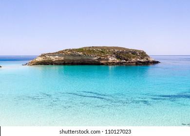Pure crystalline water surface around an island (Lampedusa)