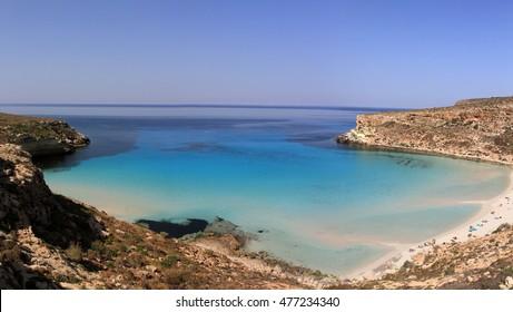 Pure crystalline water surface around an island - Lampedusa, Sicily