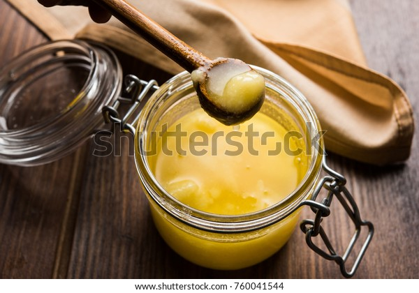 Pure OR Desi Ghee also known as clarified liquid butter. Selective focus