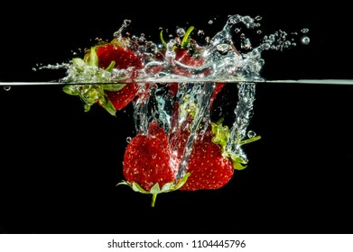 pure falling strawberry into water with splash