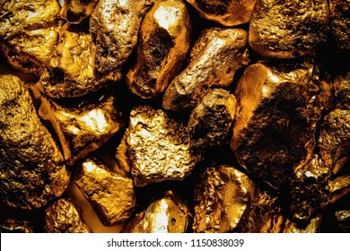 pure gold ore isolated on white background. Group of precious golden stones, A piece of raw gold digged from the mine.