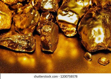 pure gold ore isolated on Reflection background. Group of precious golden stones, A piece of raw gold digged from the mine.